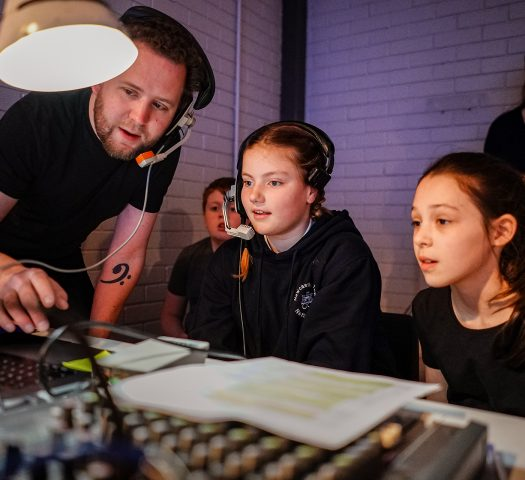Sound and Lighting Technician Alex Day teaching young people on the RSC Next Generation project