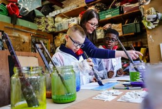 Props and Settings Maker Melissa McCann with young people taking part in the RSC Next Generation Project